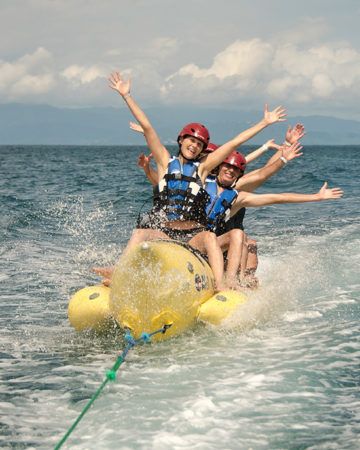 people enjoying the activity Banana Boat at Tortuga Island costa rica